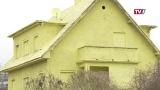 Haus in grellem Zitronengelb
